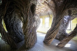 "Patrick Dougherty's art piece, ""Daydreams,"" wraps a newly built (but designed to appear old) 19th century schoolhouse in locally sourced willows."
