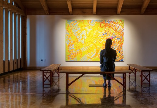 The lobby of the Olivier Barn provides exhibition space for paintings that visitors can consider prior to musical performances.