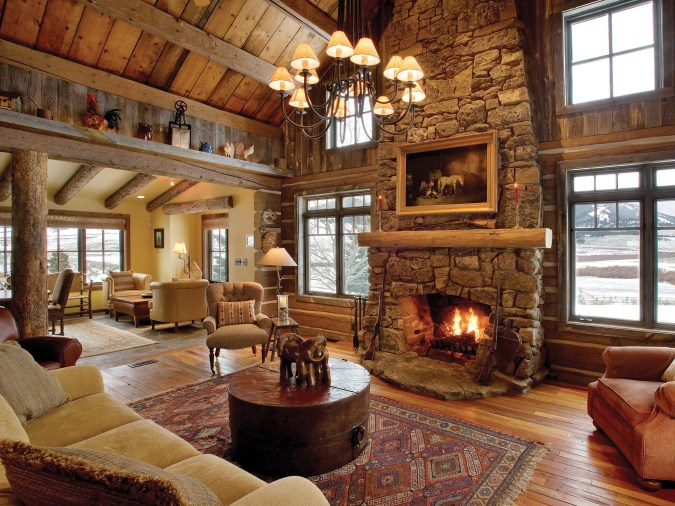 The large great room is a well-balanced blend of dovetail logs, fieldstone, and reclaimed materials.