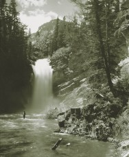 Undated photo of man fishing Trick Falls in Glacier National Park. Photo 94.2252, Rollin H. McKay, Archives and Special Collections, Mansfield Library, University of Montana - Missoula