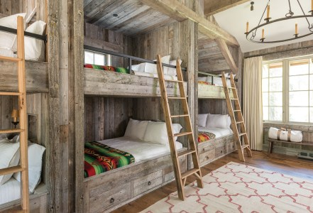 """""""Mary wanted a bunk room where she could really pack in a bunch of kids,"""" says architect Kevin Burke. She opted for three sets of queensized bunks to accommodate up to 12 guests."""