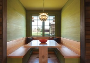 Like the colors throughout the home, the stained wood in the dining nook was designed to match colors from the landscape. The wall color is based on lichen in the area.