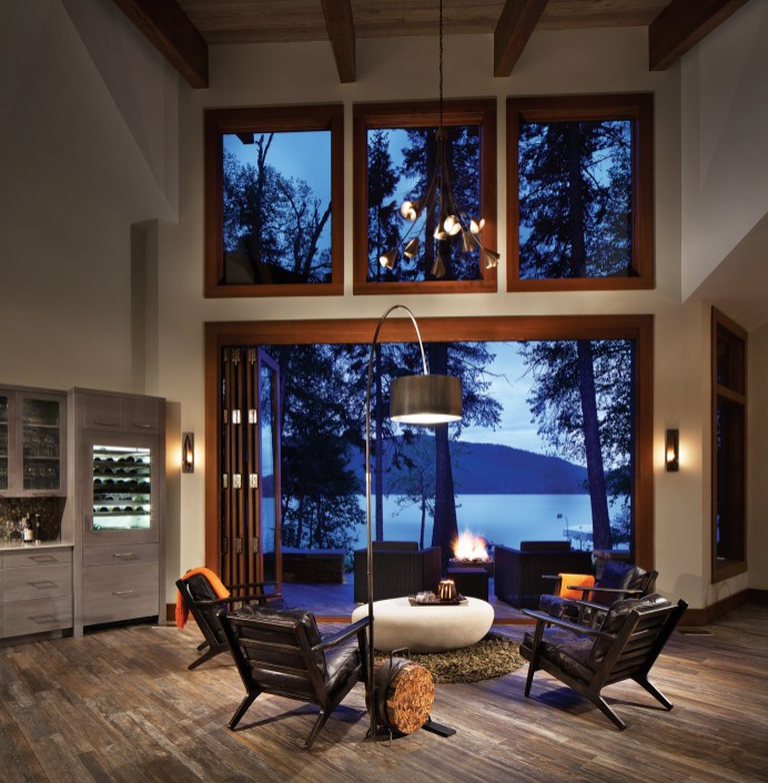 A set of 10-by-18-foot bifolding doors extends the living area to the water's edge.