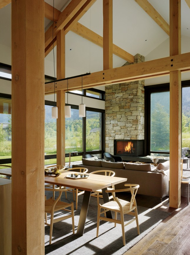 Expansive windows allow views of stunning scenery while providing a natural gathering place for the family.