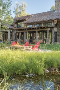 With logs that were hand hewn and stained grey, combined with Montana moss stone and grey cedar shakes, the exterior was designed to be similar in color to cottonwood bark, and somewhat camouflaged into the surrounding forest.