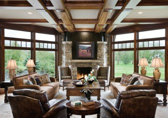 In the living room, the clean-lined furnishings reinforce the symmetry found in architectural details.