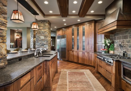 The kitchen directly overlooks the living room, allowing the family to be close together. Robertson designed the cabinetry.