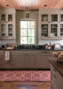 The kitchen island was designed with rich brown walnut countertops.