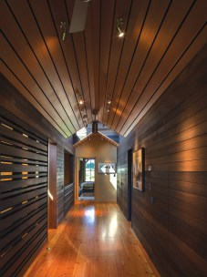 "A ""breathing wall"" creates ventilation, allowing heat to rise to the bedrooms in the colder months and dumping hot air out through the top during the hotter months. The walls are lined with Douglas fir."