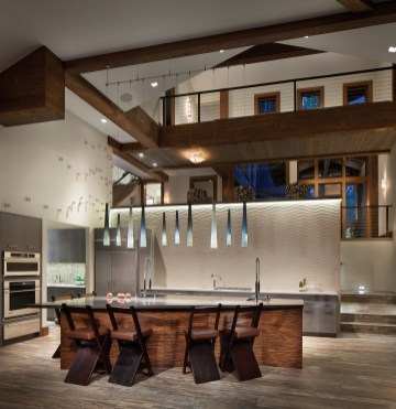 The open floor plan kitchen flows both to the skybridge and bedrooms above as well as directly to the lakefront.