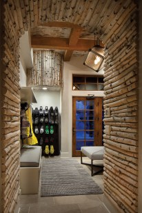 An essential in any slopeside residence, the gear room, with its aspen-lined entryway, is a primer to what waits outside.