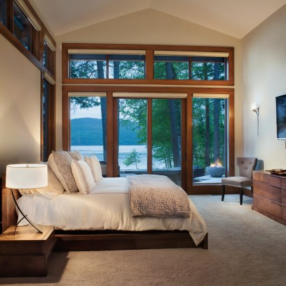 Tone-on-tone interior elements in the bedroom enhance the natural landscape surrounding the home.