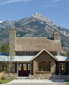 The stone, log, metal and shingles incorporated into the home design artfully conspire to showcase the dramatic backdrop of Ross Peak.