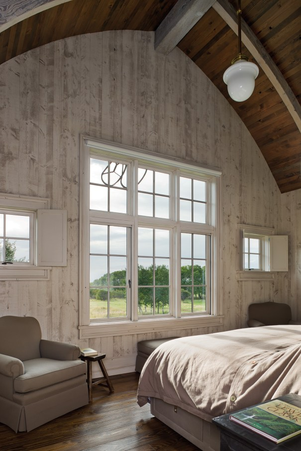 On the third floor, in what would have been the hay loft of a traditional barn, a luxurious bedroom looks out onto the Gallatin Valley.