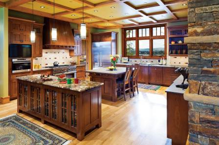 The spacious, open kitchen features a butler's pantry and counters made of petrified wood.
