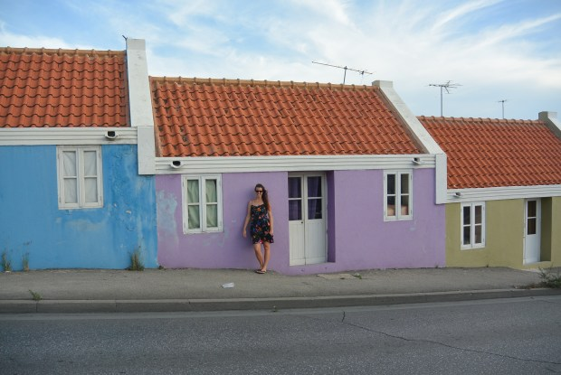 Brittany in front of purple building