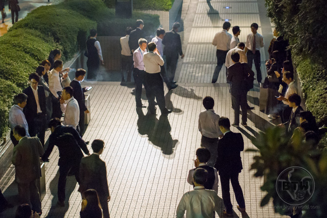 Businessmen smoking outside in Tokyo