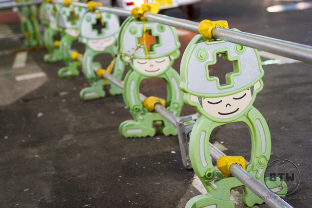 Construction barriers in Tokyo, Japan, shaped like little men in green outfits
