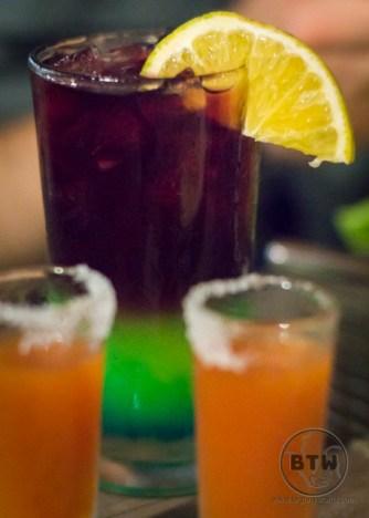 A colorful guacamaya drink with a slice of orange   BIG tiny World Travel