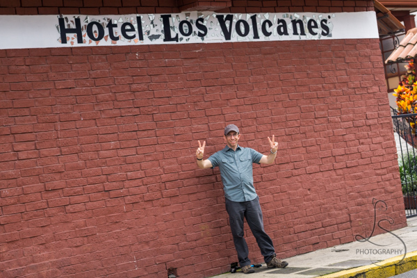 Aaron in front of the Hotel Los Volcanes sign