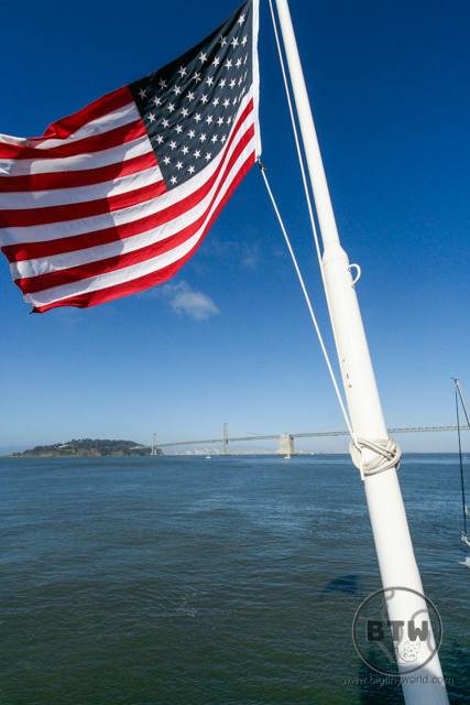An American flag off the bow of a ship on the San Francisco Bay | BIG tiny World Travel