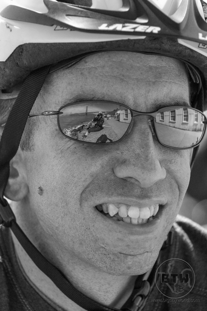 Close-up of Aaron wearing a helmet and sunglasses | BIG tiny World Travel