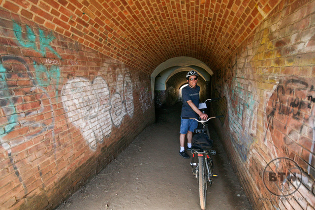 Aaron standing next to the bike in a tunnel in San Francisco | BIG tiny World Travel