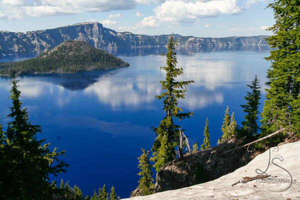 Blue Crater Lake under a blue sky | BIGtinyWorld Travel