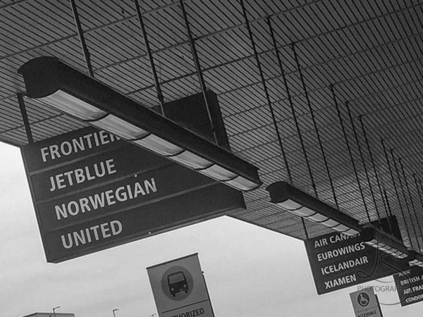 Signs outside the Seattle Airport denoting the many different airlines | BIG tiny World Travel