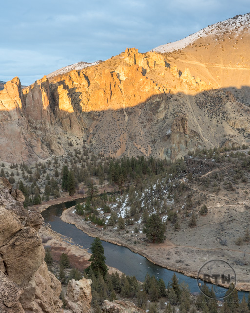 Sun hitting just the upper edge of the far ridge in Smith Rock State Park