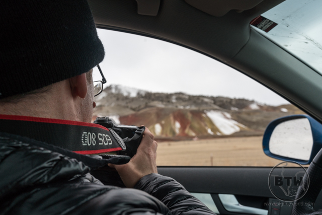 Aaron photographing a snowy Painted Hills from the car's driver seat in Oregon | BIG tiny World Travel