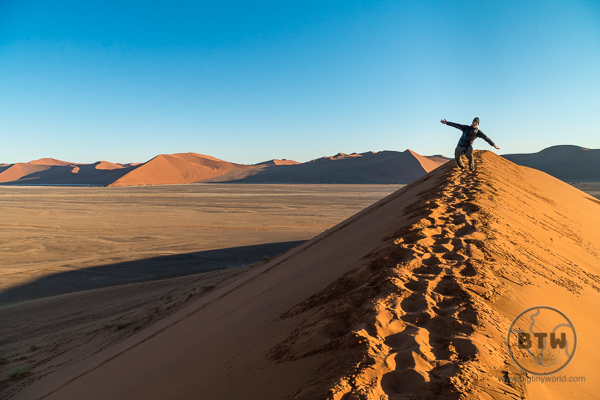 Aaron enjoying the Namibian sunrise from atop the famed Dune 45