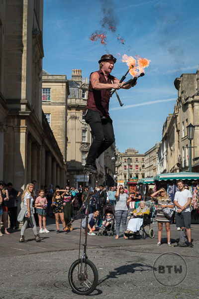 Street Performer Bath (Juggling fire on an elevated unicycle)