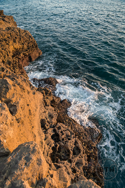 Waves crashing against the rocky cliff at Boca Inferno