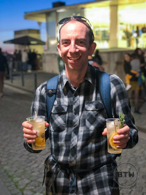 Aaron Shade holding two port tonics in Gaia