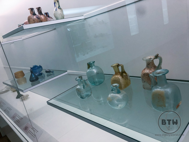 Old small glass jars on display at the Museum of Ancient Glass in Zadar, Croatia