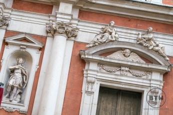 Facade statues in Modena, Italy