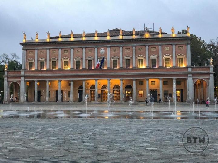 Fountain and building in Reggio Emilia, Italy
