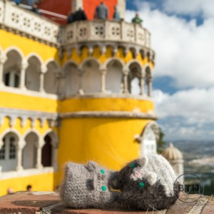 Our crocheted travel kitties lounging in the sun at Sintra's Pena Palace in Portugal