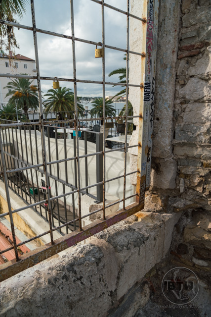A window grate looking out onto the waterfront in Split, Croatia