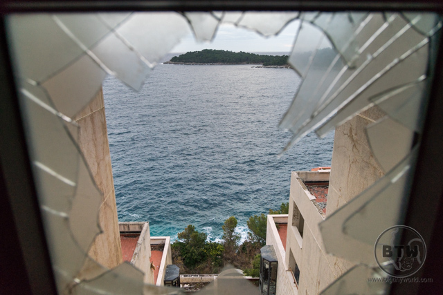 Looking at the ocean out a broken window at the ruins of the Belvedere Hotel in Dubrovnik, Croatia