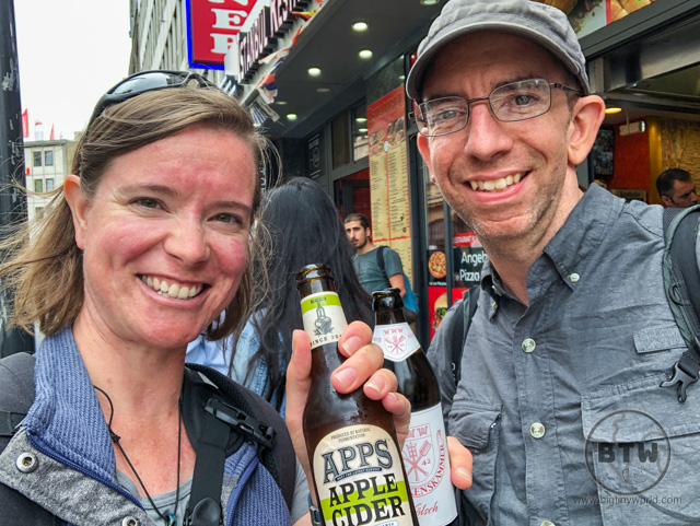 Aaron and Brianna showing off their bottles of beer and cider on the street in Cologne, Germany