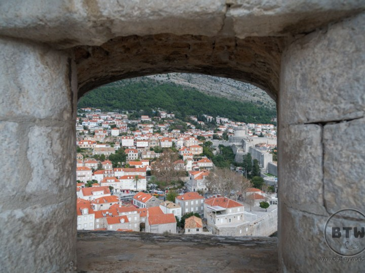 Peeking out at the houses through a hole the wall of Dubrovnik, Croatia