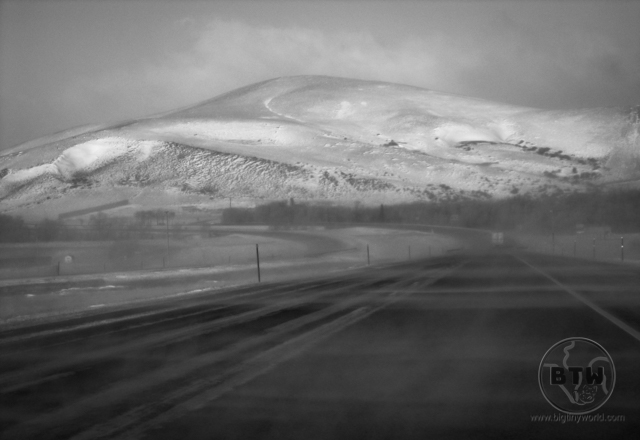 A snowy hillside and a highway in Idaho