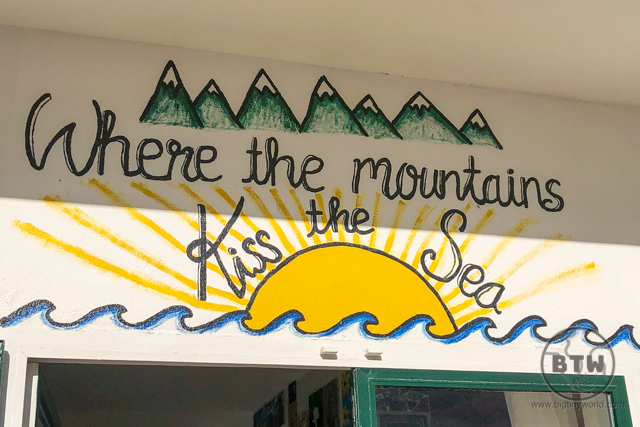 "A sign over the door of a hostel in Omis, Croatia, that reads, ""Where the mountains kiss the sea"""