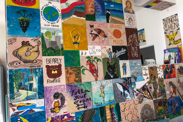 A wall of tiled paintings in a hostel in Omis, Croatia