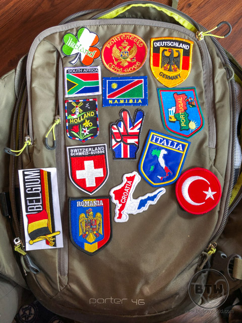 A backpack covered in an assortment of patches from various countries