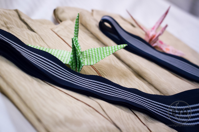 Folded yukata robes with origami cranes in a hotel in Tokyo, Japan