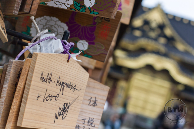 Asking for good fortune outside a Japanese shrine outside of Ueno Park, Tokyo.