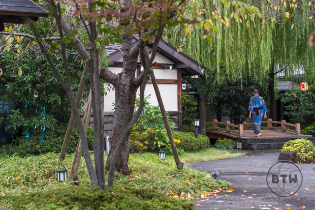 Aaron walking across the garden courtyard at the Ouedo Onsen in Odaiba, Tokyo, Japan